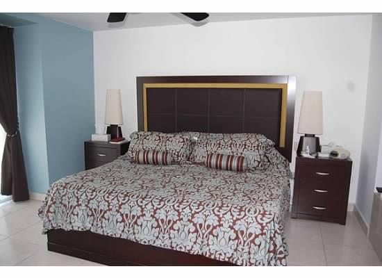 Cama habitación principal Área cocina Condominio Villa Magna Nuevo Vallarta