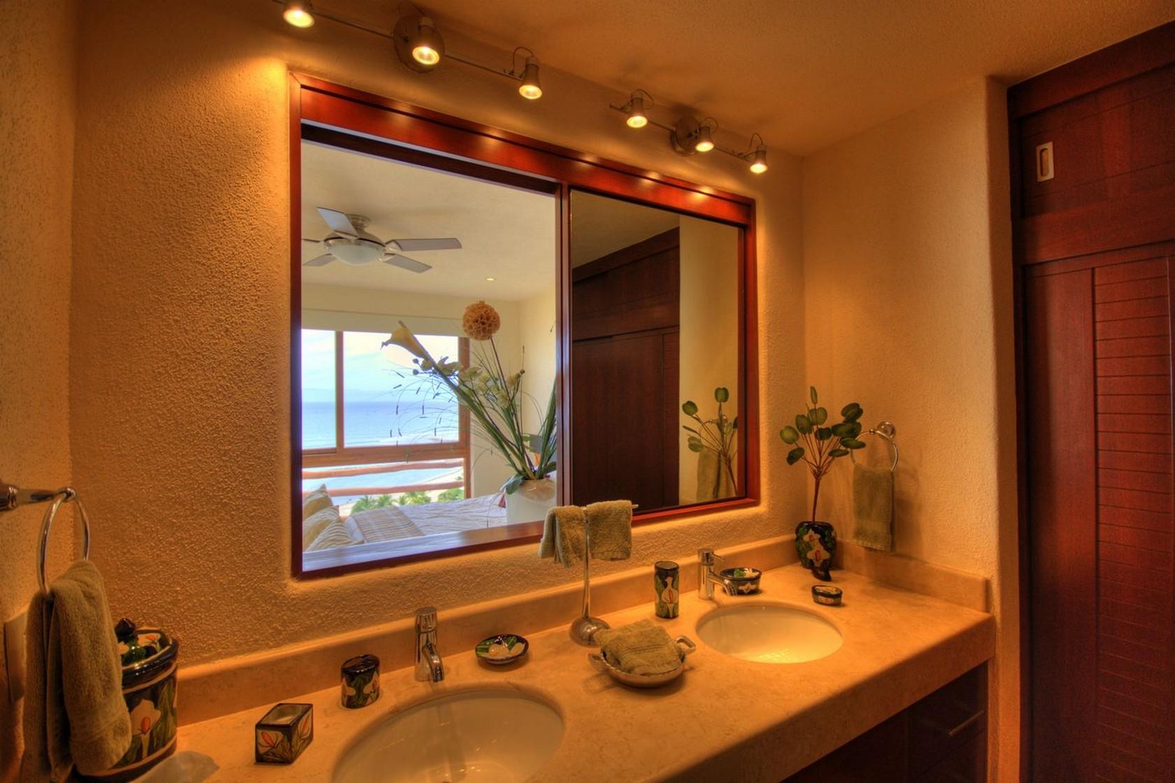 Espejo baño Departamento en venta Punta Esmeralda Resort La Cruz de Huanacaxtle