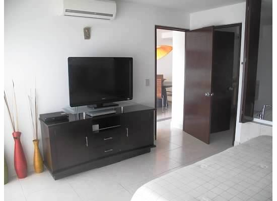 Televisión pantalla planta en habitación Condominio Villa Magna Nuevo Vallarta